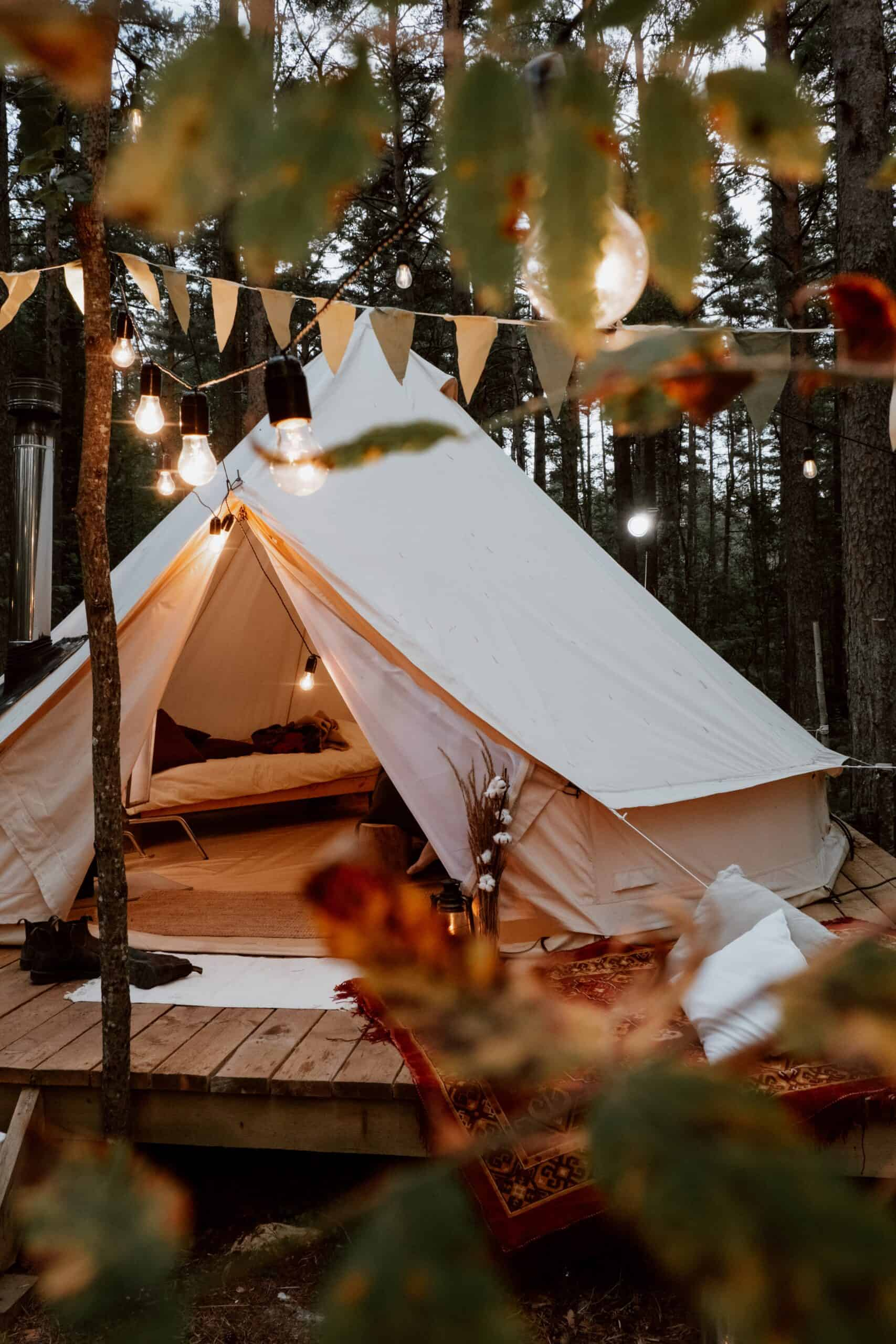 A glamping tent seated above a wooden platform